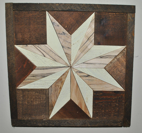 Dark wood quilt square with large white and light wood star in the center