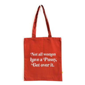 "Burnt orange tote bag with white ""Not all women have a pussy, get over it"" print on it."