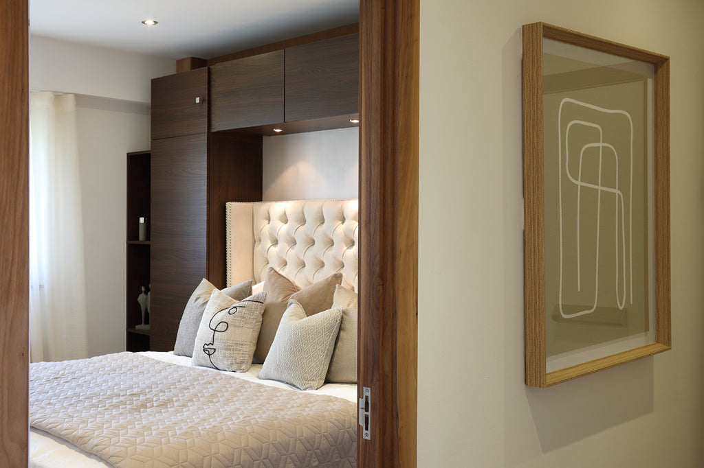 Large bedroom with artwork in the corridor
