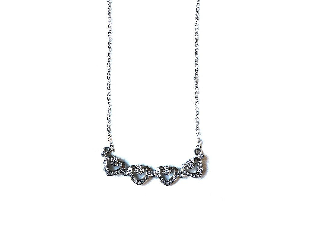 Four Heart Magnet Necklace.