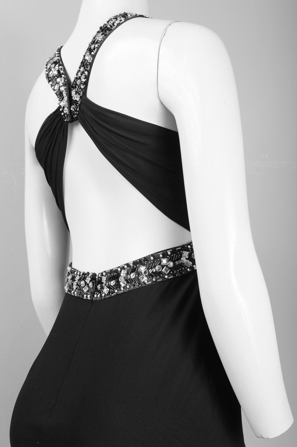 Decode Neckline and keyhole dress with twisted strap.