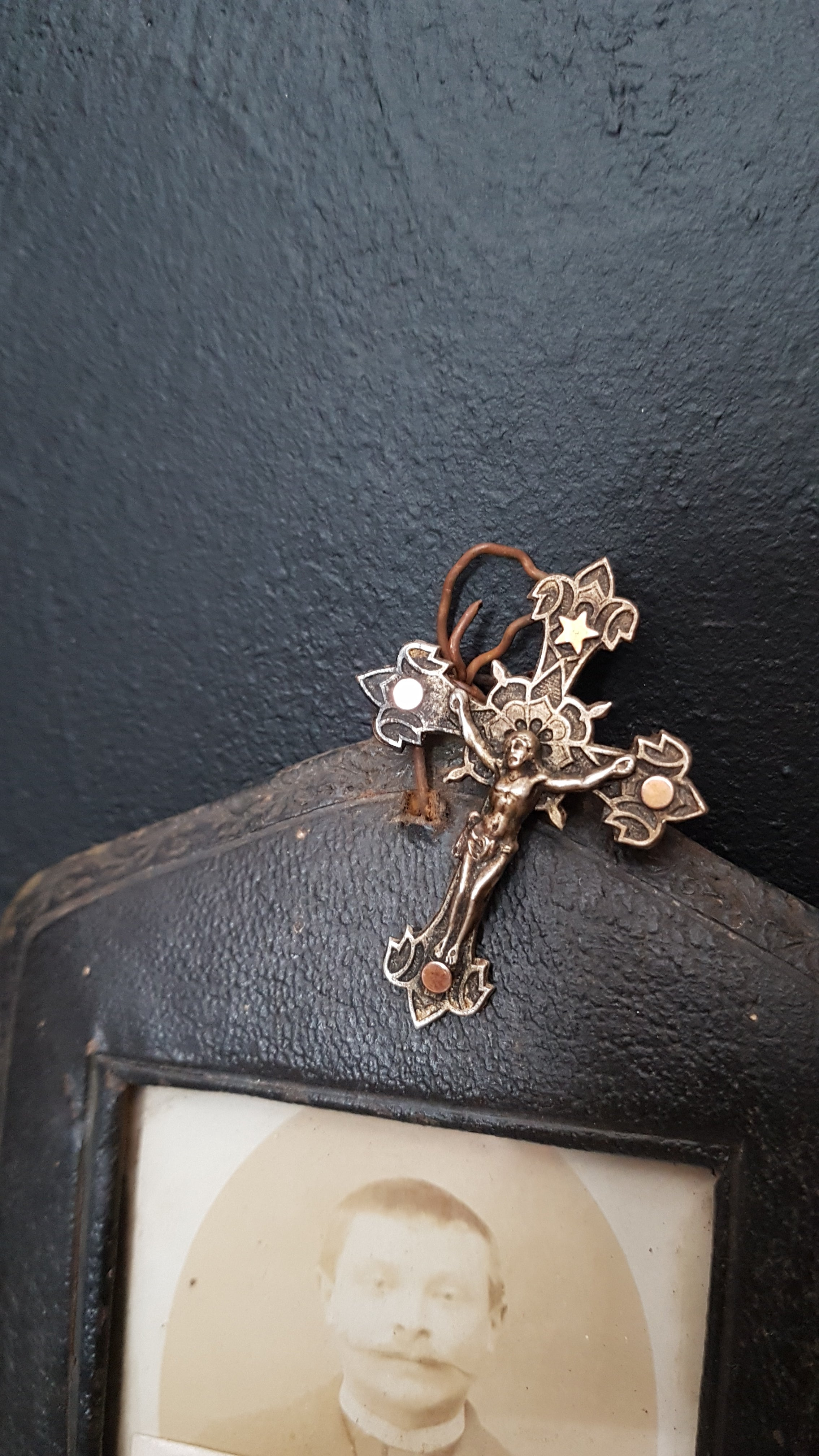 Antique crucifix brooch attached to picture frame. Victorian jewellery