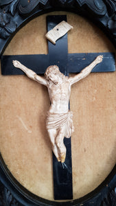 Antique frame with crucifix. Plaster Corpus Christi