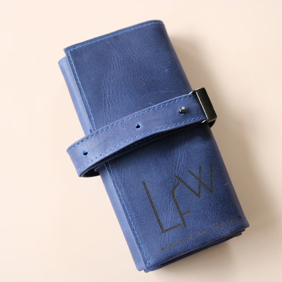 A High end handcrafted leather watch pouch in blue aged patina style leather with LFW logo