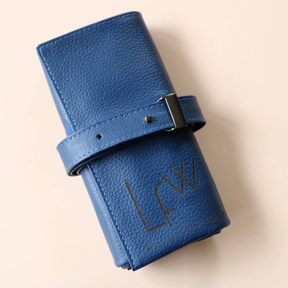 A High end handcrafted leather watch pouch in blue grain leather with LFW logo