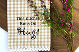 This Kitchen Runs on Hugs Tea Towel