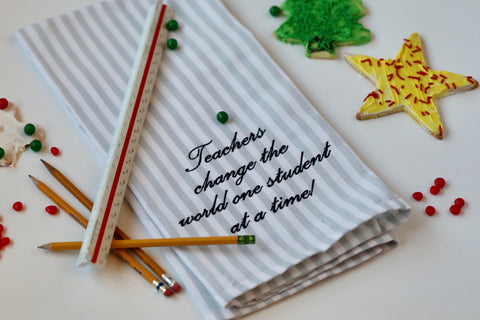 """Teachers change the world one student at a time!"" Tea Towel"