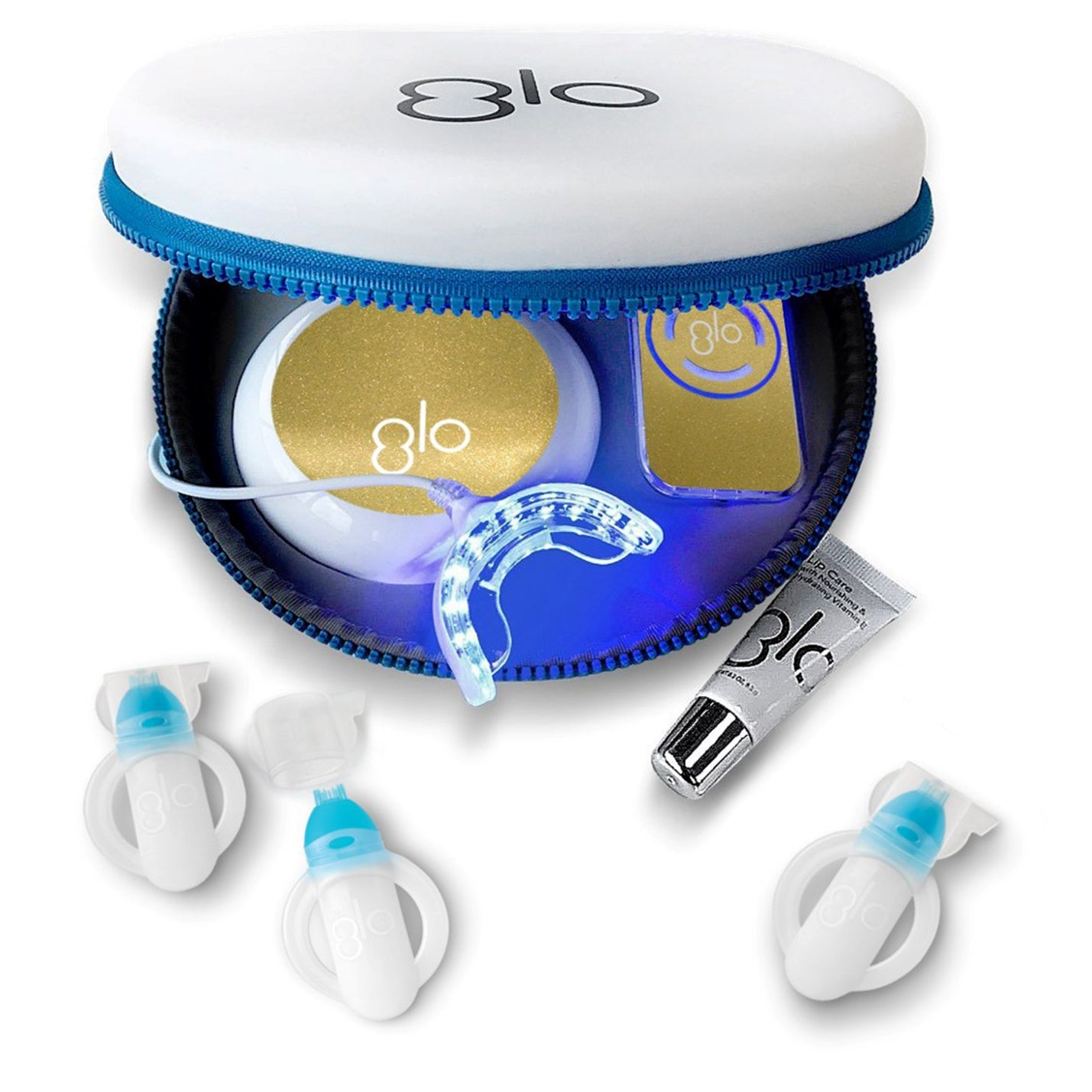 Complete GLO Brilliant teeth whitening system in gold, arranged in a round storage container.