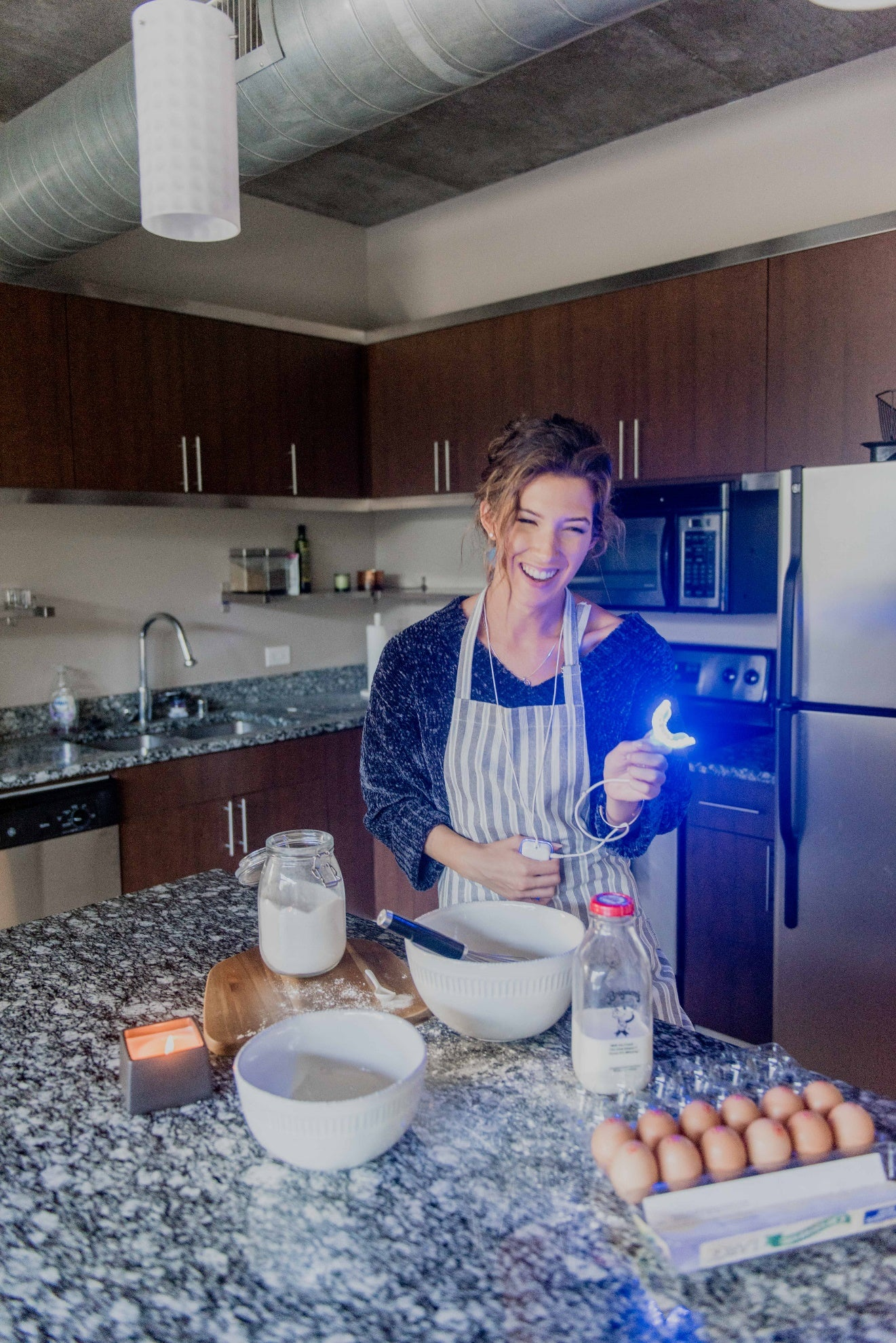 Description: A person cooking in a kitchen Description automatically generated with medium confidence