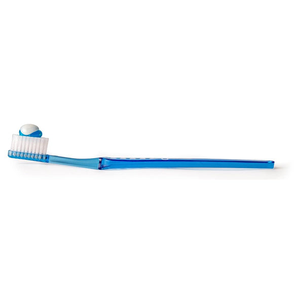 Blue toothbrush facing up with gel toothpaste on the bristles on a white background.