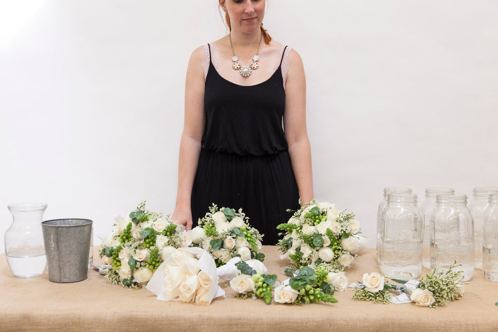 Arranged Wedding Flowers with vases, buckets, supplies