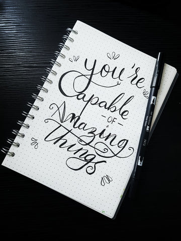 Positive journal quote - you're capable of amazing things - Photo by Alysha Rosly on Unsplash