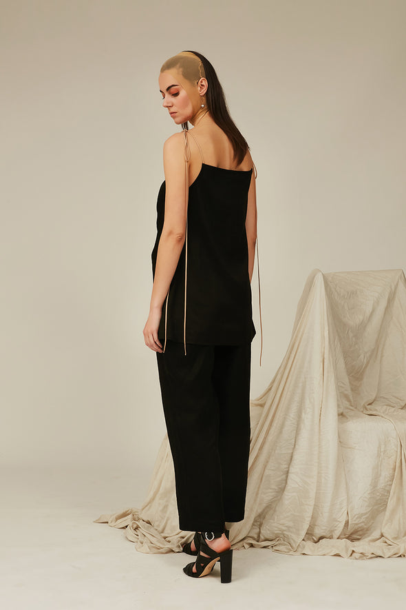 black slip top and pleated pants