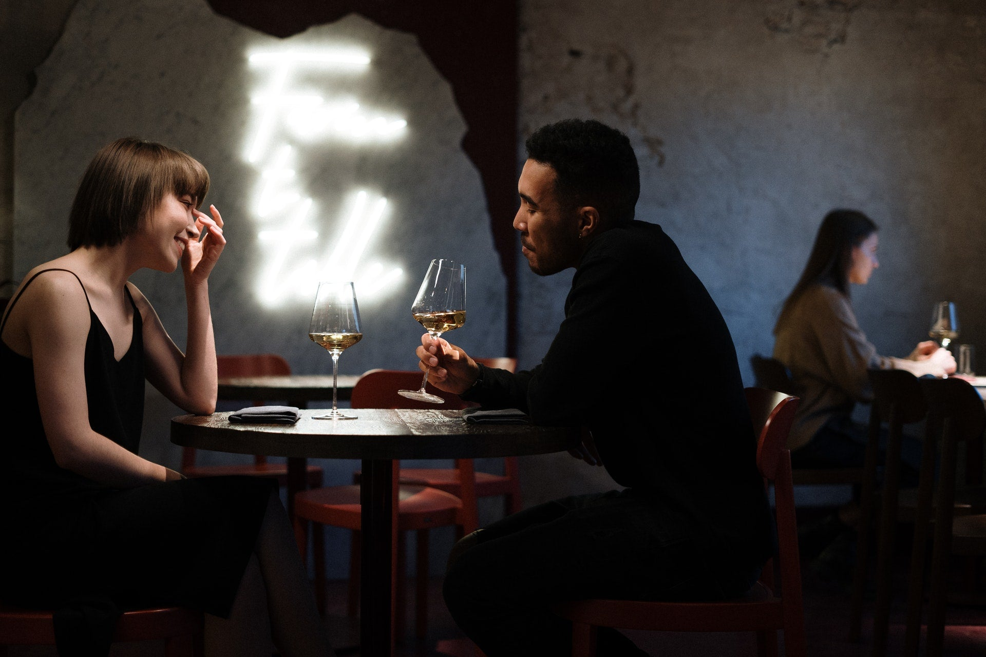 couple in love drinking wine from glasses