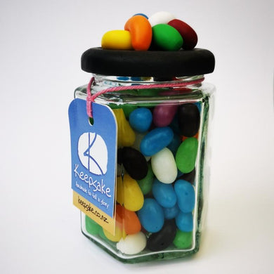 270ml glass hexagonal lolly jar hand-decorated in New Zealand, with  an air-tight lid decorated with polymer clay jelly beans. Filled with jelly beans