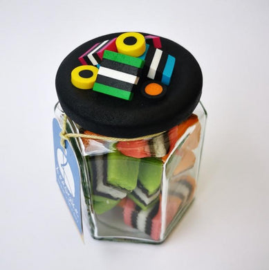 270ml glass hexagonal lolly jar hand-decorated in New Zealand, with  an air-tight lid decorated with polymer clay licorice allsorts. Filled with licorice allsorts.
