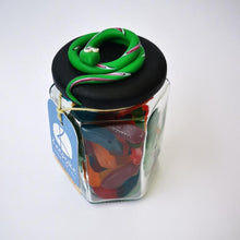 Load image into Gallery viewer, 270ml glass hexagonal lolly jar hand-decorated in New Zealand, with  an air-tight lid decorated with a  polymer clay snake. Filled with snake lollies