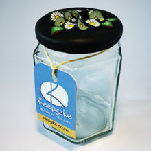Load image into Gallery viewer, 270ml glass hexagonal  jar and lid hand-decorated in New Zealand, with  an air-tight lid decorated with polymer clay daisies in a daisy chain. Ready to be filled with fudge, sweets or other treasures.