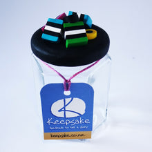 Load image into Gallery viewer, 185ml glass hexagonal  jar and lid hand-decorated in New Zealand, with  an air-tight lid decorated with polymer clay licorice allsorts. Ready to be filled with licorice allsorts, sweets or other treasures.