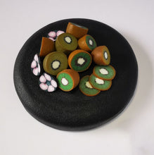 Load image into Gallery viewer, Upcycle your jar with an air-tight lid, hand-decorated in New Zealand. Decorated with miniture polymer clay Kiwifruit. Standard fitting  (63mm) so it fits jars you have at home. Gift boxed in an attractive matchbox.