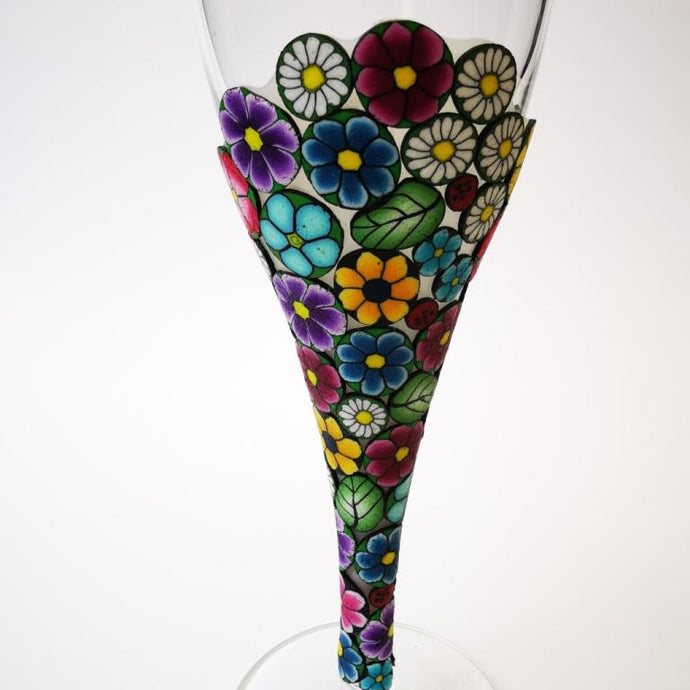 Champagne flute wine glass hand-decorated in New Zealand,  with a polymer clay veneer of pretty, colourful,  flowers for a gift, wedding or special birthday.