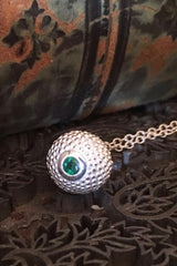 A special May birthstone pendant in silver – a tactile textured ball with a glistening Emerald at the base