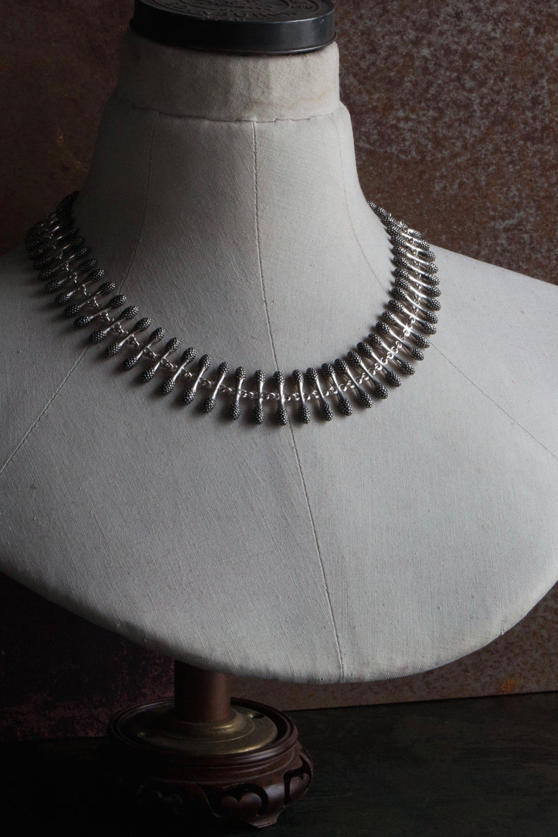 My Spot the Matchstick Necklace in oxidised silver formed from small linked 'matchstick' bars with a bobble texture