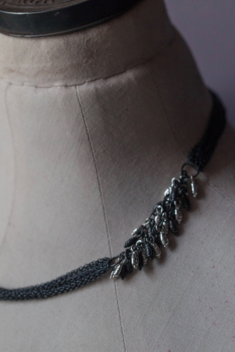 Rice Pearl Necklace in oxidised silver featuring eight chains decorated with groups of rice pearl beads