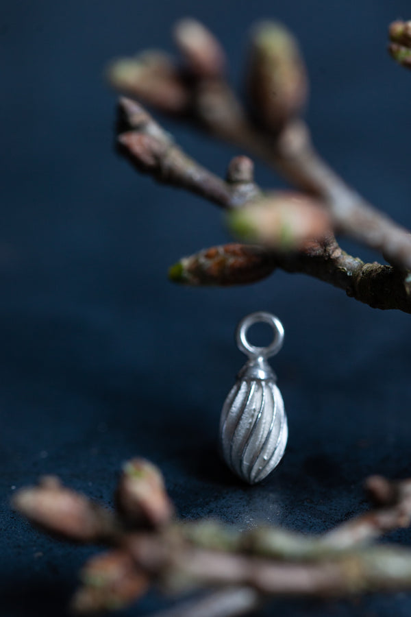 Twisted Droplet Charm