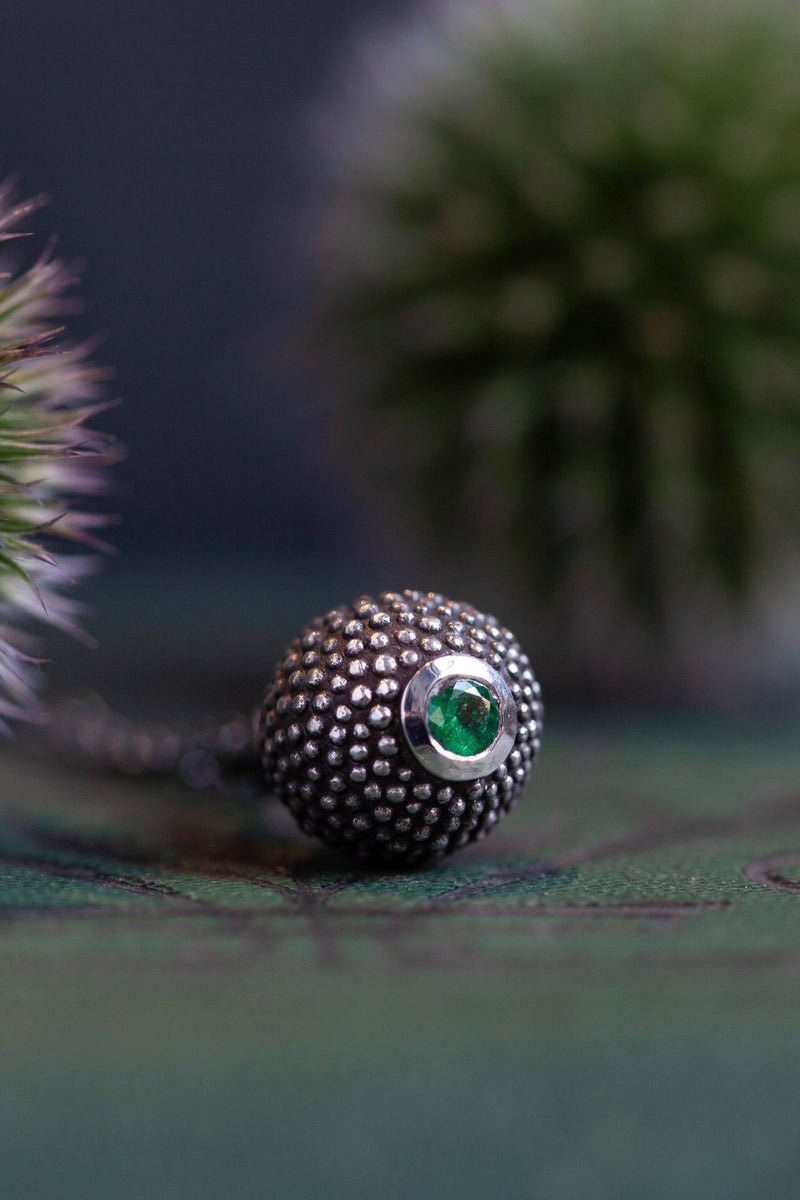 A special May birthstone pendant in oxidised silver – a tactile textured ball with a glistening Emerald at the base