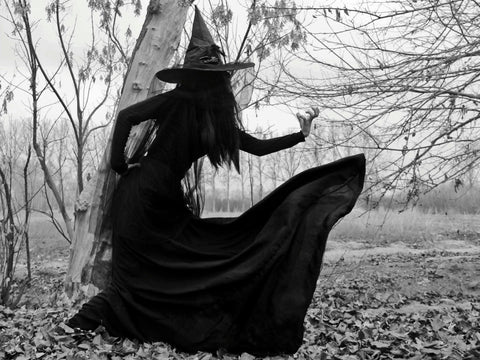All black image of a witch
