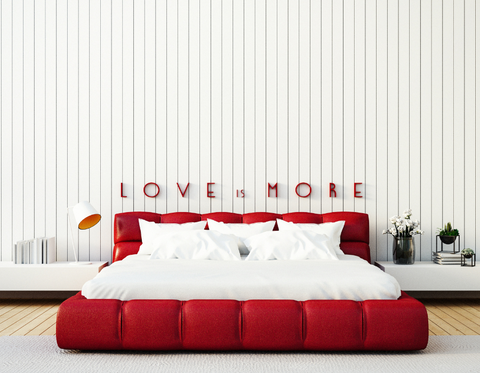 Love is more sign over a bed