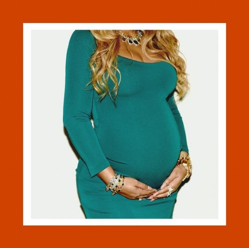 an image of Beyonce Knowles-Carter carrying twins, like my mother, who carried my sister and i. know that this piece is indeed a tribute to her love and strength as our mother.  image source: beyonce.com
