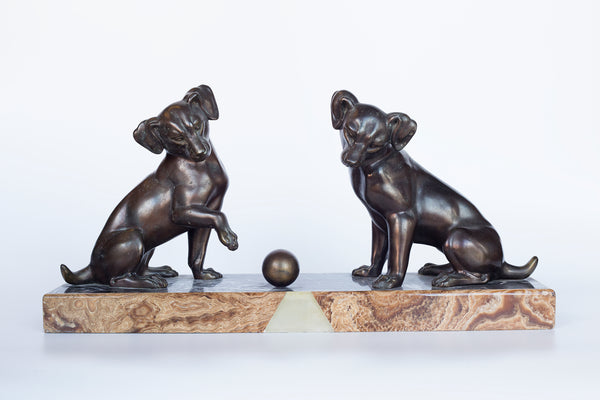 "Bronze sculpture on a Marble plinth ""Two Fox Terrier puppies playing with a ball"" by Irenee Rochard"