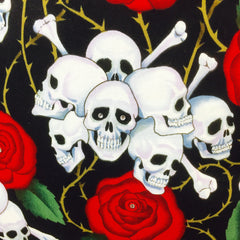 Skulls, Bones and Roses cushion featuring Alexander Henry fabric at The Scallywag Society