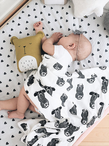 The skating sloth baby blanket from Doctor Mother Other makes a perfect newborn gift. Made from 100% cotton and handmade in the UK.