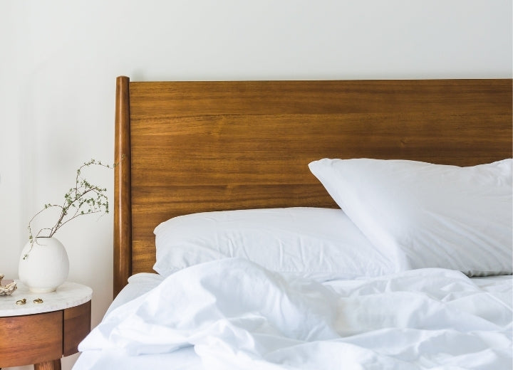 Timber Bed with White Sheets and Pillows