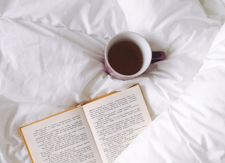 White Bedpread with Tea and a Book