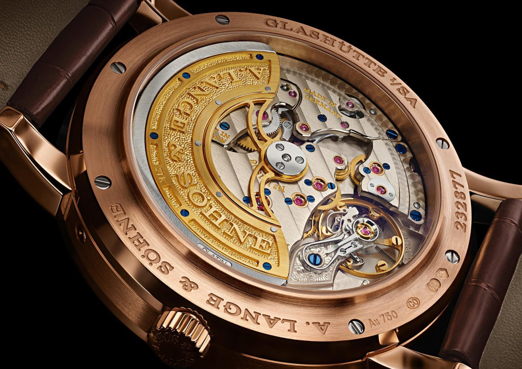 view from the back of an A. Lange & Söhne watch showing the movment