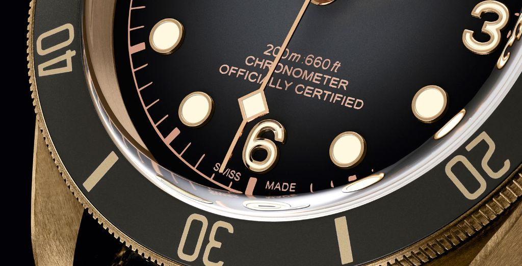 Close up of COSC dial markings on a Tudor Black Bay Heritage
