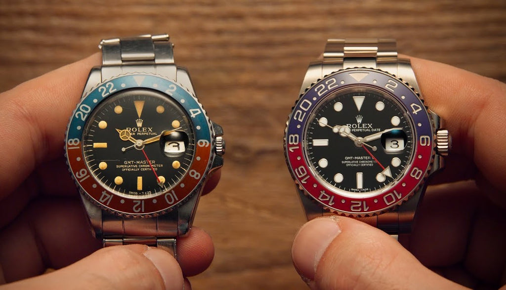 Man holding a vintage gmt pepsi rolex and a modern gmt pepsi rolex