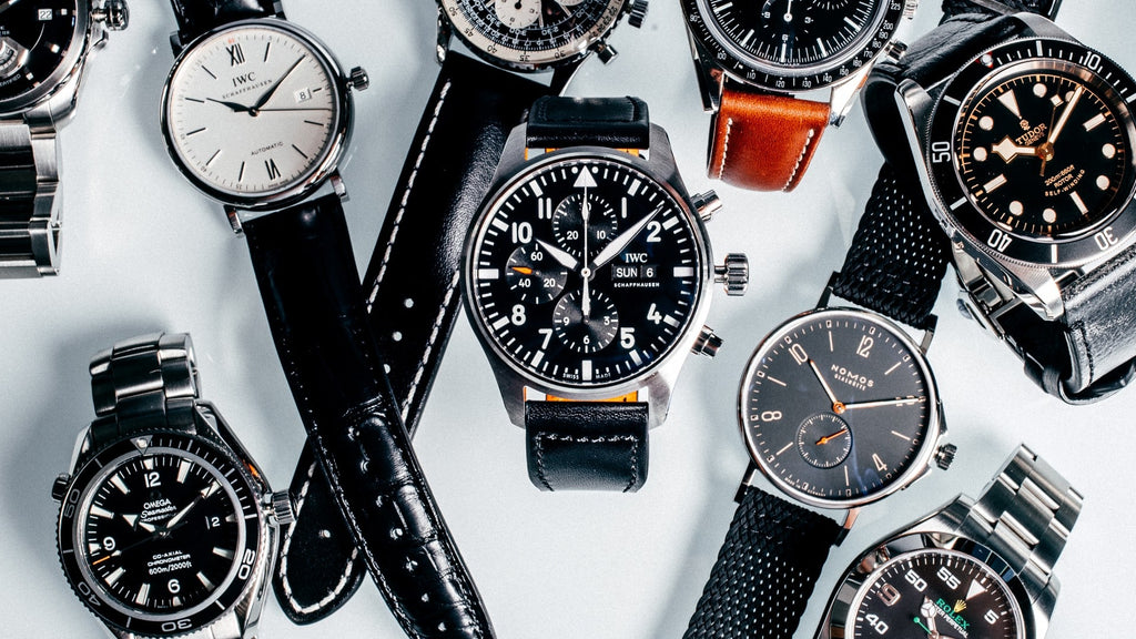 collection of watches layed out on table