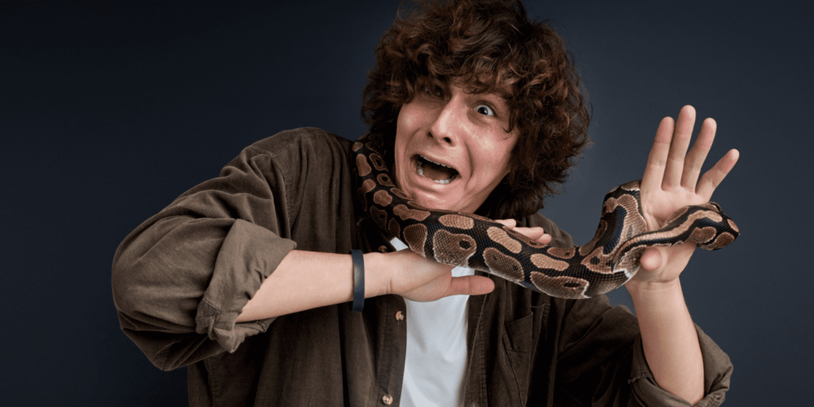 snake around the neck of a scared man