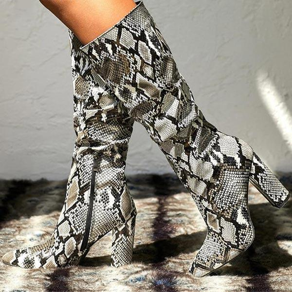 Thigh high snake skin boots on female