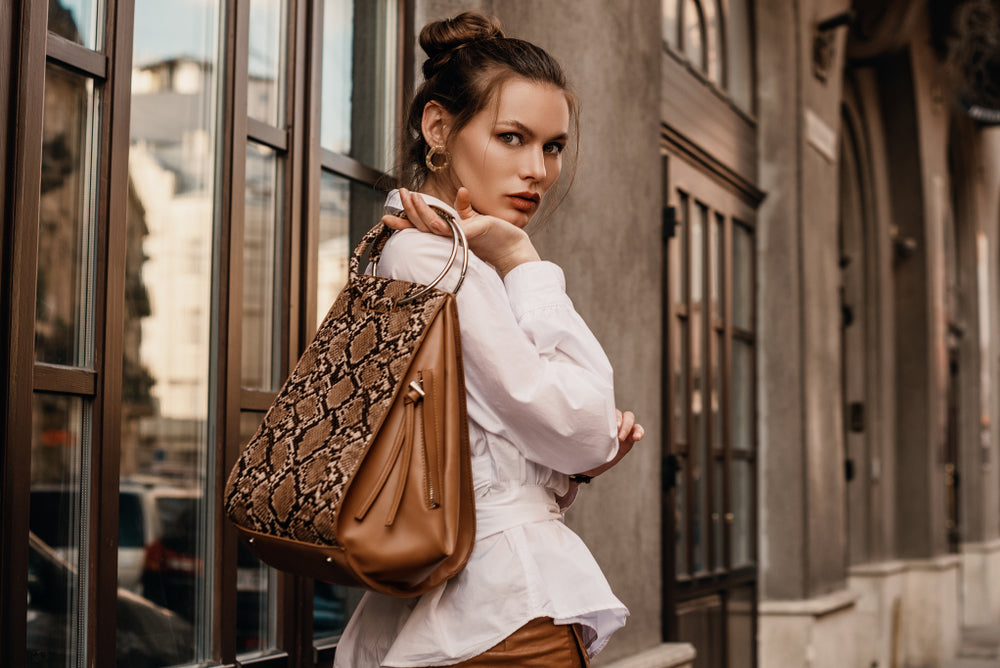 Woman with a snake bag