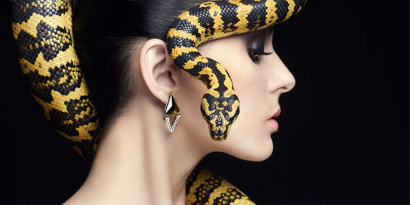 Woman with snake of head