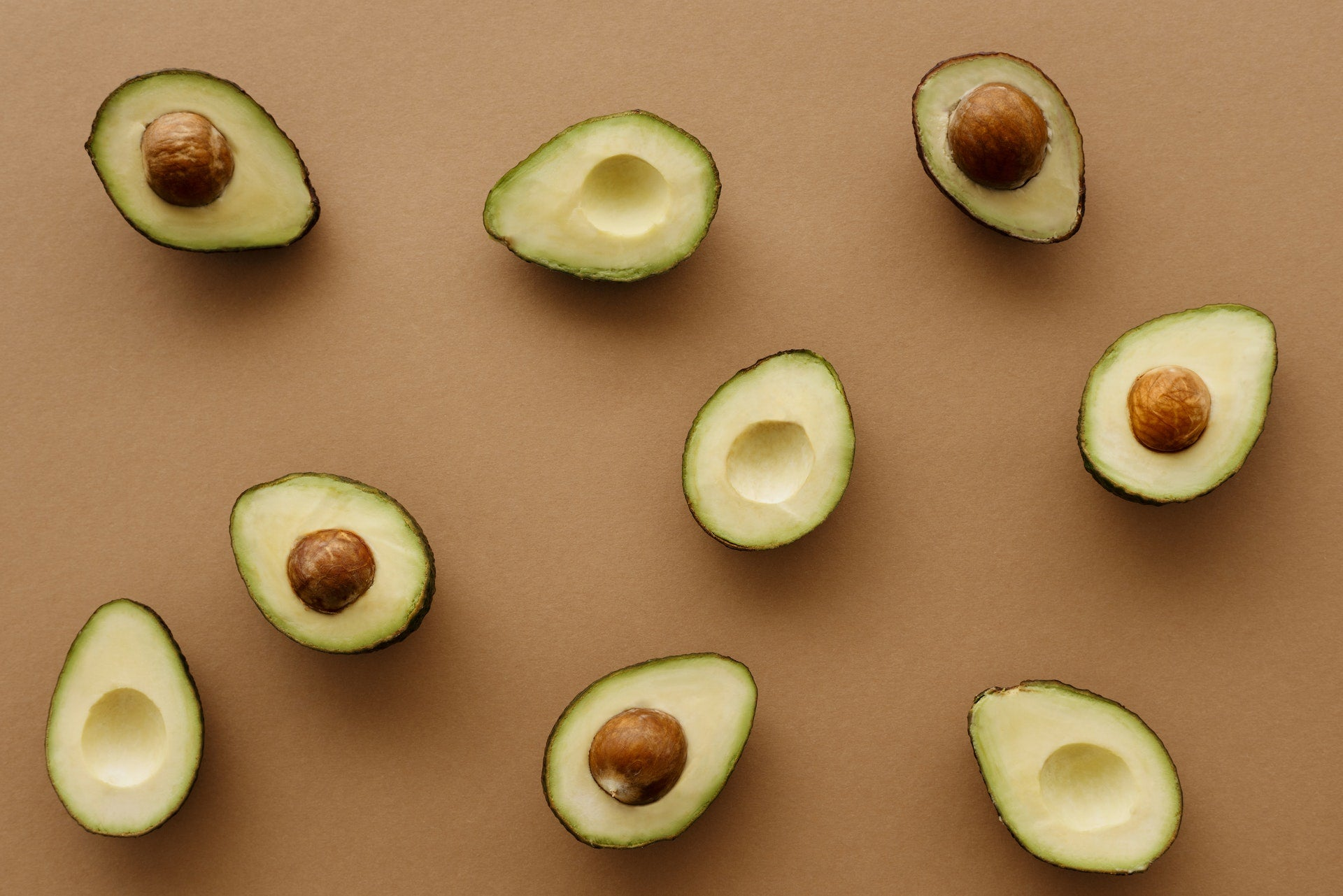 Avocados, a food high in magnesium, cut in half.