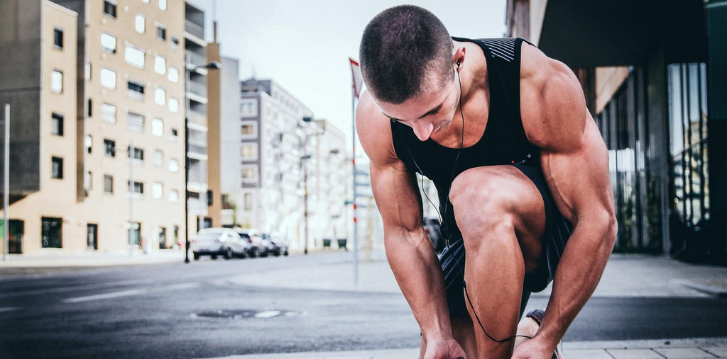 man exercising on the street to boost energy