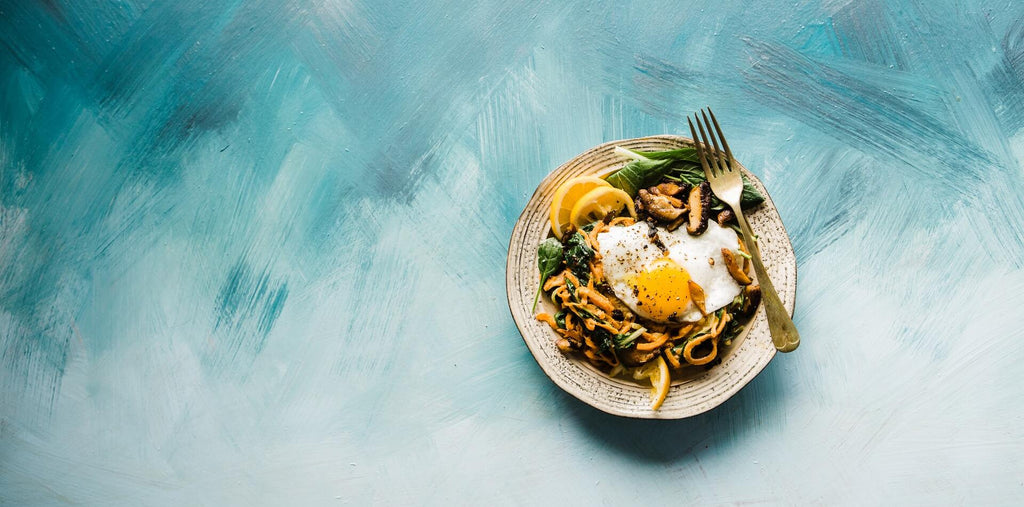 breakfast pasts with fried egg and greens
