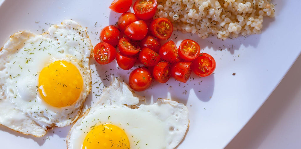 fried eggs tomatoes and kale for morning breakfast
